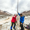 "Professor Regine Hock, a glaciologist with UAF's Geophysical Institute, and Tristan Weiss, a research technician with the Institute of Northern Engineering, measure the depth of the ice near the toe of the Jarvis Glacier in the eastern Alaska Range.  <div class=""ss-paypal-button"">Filename: AAR-14-4256-431.jpg</div><div class=""ss-paypal-button-end""></div>"