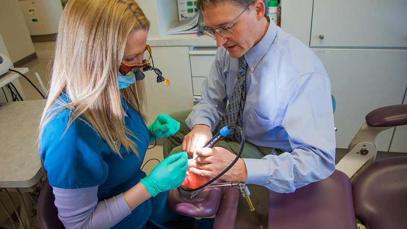 "Program director Vaughan Hoefler works with one of his students in CTC's dental hygienist program in their training facility in downtown Fairbanks.  <div class=""ss-paypal-button"">Filename: AAR-12-3308-038.jpg</div><div class=""ss-paypal-button-end"" style=""""></div>"