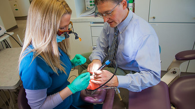 Program director Vaughan Hoefler works with one of his students in CTC's dental hygienist program in their training facility in downtown Fairbanks.  Filename: AAR-12-3308-038.jpg