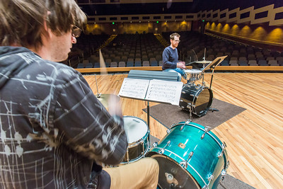 Percussionist Sean Dowgray works with Professor Morris Palter during class, MUS F606 - Advanced Chamber Music - Percussion, in the Davis Concert Hall.  Filename: AAR-14-4094-25.jpg