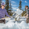 "Daisy Huang, a research engineer for the Alaska Center for Energy and Power, works with intern Luke George to clear snow needed to install a SODAR station on a hillside near the Black Rapids Lodge, about 150 miles southeast of Fairbanks. The station uses sound waves to measure atmospheric distrubances to produce a profile of wind speed and direction at a range of altitudes.  <div class=""ss-paypal-button"">Filename: AAR-13-3843-59.jpg</div><div class=""ss-paypal-button-end"" style=""""></div>"