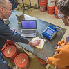"Professor David Barnes analyzes data collected in the field with undergraduate engineering major Logan Little as part of their research on dust abatement.  <div class=""ss-paypal-button"">Filename: AAR-13-3812-51.jpg</div><div class=""ss-paypal-button-end"" style=""""></div>"