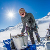 "Geophysical Institute graduate student Joanna  Young sets up a steam drill to install stakes for measuring glacier melt on the Jarvis Glacier, about 35 miles south of Delta Junction.  <div class=""ss-paypal-button"">Filename: AAR-13-3795-535.jpg</div><div class=""ss-paypal-button-end"" style=""""></div>"
