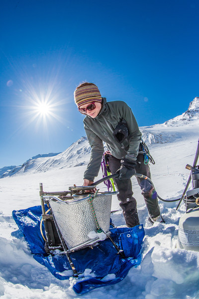 """Geophysical Institute graduate student Joanna  Young sets up a steam drill to install stakes for measuring glacier melt on the Jarvis Glacier, about 35 miles south of Delta Junction.  <div class=""""ss-paypal-button"""">Filename: AAR-13-3795-535.jpg</div><div class=""""ss-paypal-button-end"""" style=""""""""></div>"""