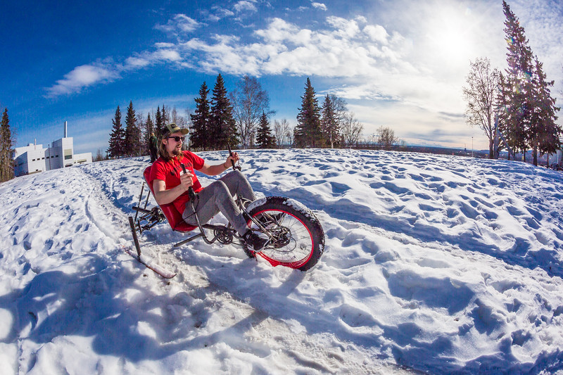 """Mechanical engineering major Eric Bookless demonstrates the fat tire ski bike he and two partners designed and built for paraplegic users as their spring 2016 senior design project. The bike is powered by pushing and pulling on the handles.  <div class=""""ss-paypal-button"""">Filename: AAR-16-4856-35.jpg</div><div class=""""ss-paypal-button-end""""></div>"""