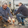 "Chet Chambers, a sustainable energy technician at UAF's Bristol Bay campus in Dillingham, works with Professor Mike Davis to demonstrate how to use a bicycle to power a light bulb.  <div class=""ss-paypal-button"">Filename: AAR-12-3390-024.jpg</div><div class=""ss-paypal-button-end"" style=""""></div>"