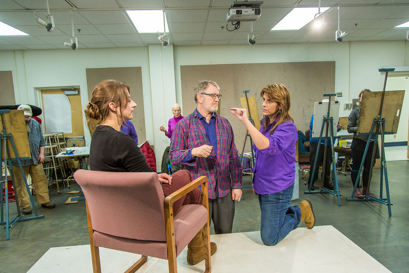 """Professor Todd Sherman, dean of UAF's College of Liberal Arts, works with Marilyn Childress in his portrait painting class offered during the 2014 Wintermester in the Fine Arts complex.  <div class=""""ss-paypal-button"""">Filename: AAR-14-4032-67.jpg</div><div class=""""ss-paypal-button-end"""" style=""""""""></div>"""