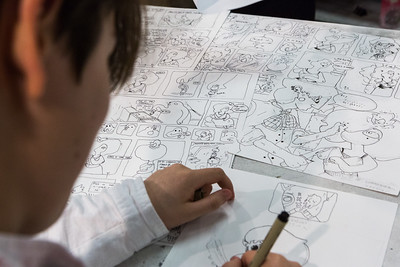 A Visual Arts Academy student completes a comic strip at the Fine Arts Complex on the Fairbanks campus.  Filename: AAR-16-4917-142.jpg