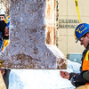 "Engineering students clear the bottom of one of the vertical supports as they raise the 2013 ice arch in Cornerstone Plaza on the Fairbanks campus. Students this year built the structure out of a mixture of ice and sawdust, which is many times stronger than concrete.  <div class=""ss-paypal-button"">Filename: AAR-13-3736-114.jpg</div><div class=""ss-paypal-button-end"" style=""""></div>"