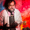 "Geology professor Rainer Newberry pours hot lava over volcanic basalt during a set-up photoshoot in a Reichardt Building lab in on the Fairbanks campus.  <div class=""ss-paypal-button"">Filename: AAR-13-3732-35.jpg</div><div class=""ss-paypal-button-end"" style=""""></div>"