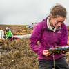 """Ludda Ludwig, a Ph.D. candidate with UAF's College of Natural Science and Mathematics, collects water samples from a research site near the headwaters of the Kuparuk River on Alaska's North Slope.  <div class=""""ss-paypal-button"""">Filename: AAR-14-4217-058.jpg</div><div class=""""ss-paypal-button-end""""></div>"""