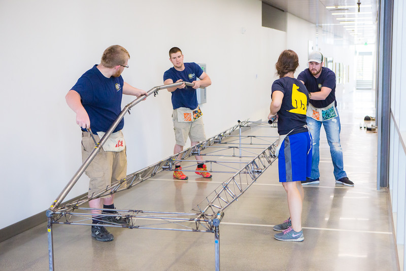 """The 2016 UAF Steel Bridge team practices in the hallway of the Duckering Building before competing in the national competition.  <div class=""""ss-paypal-button"""">Filename: AAR-16-4888-17.jpg</div><div class=""""ss-paypal-button-end""""></div>"""