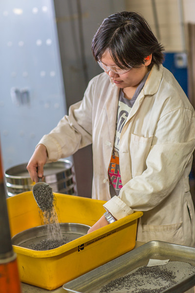 """Hsin-Hui Yen filters crushed ore through a sieve as part of her research at the Mineral Industry Research Lab (MIRL) facility in the barn at the UAF Agricultural and Forestry Experiment Station.  <div class=""""ss-paypal-button"""">Filename: AAR-12-3549-127.jpg</div><div class=""""ss-paypal-button-end"""" style=""""""""></div>"""