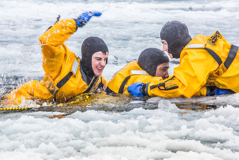 "Maxwell Delzer, left, Jordan Sanchez, and Joshua Stern practice cold-water rescue techniques this morning with the University of Alaska Fairbanks Fire Department.  <div class=""ss-paypal-button"">Filename: AAR-13-3797-71.jpg</div><div class=""ss-paypal-button-end"" style=""""></div>"