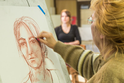Hana Esop sketches the subject during the portrait painting class in the UAF Fine Arts complex, offered during Wintermester 2014.  Filename: AAR-14-4032-49.jpg