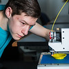 "Stephen Ramirez, keeps an eye on the progress on his project during an open work session in UAF's Community and Technical College's 3-D print lab in downtown Fairbanks.  <div class=""ss-paypal-button"">Filename: AAR-16-4857-105.jpg</div><div class=""ss-paypal-button-end""></div>"