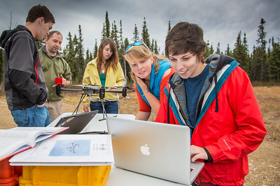 Students take part in a project using unmaned aerial vehicles (UAVs) at Poker Flat Research Range about 40 miles northeast of the Fairbanks campus. (Note: Taken as part of commercial shoot with Nerland Agency. Pretend class -- use with discretion!)  Filename: AAR-12-3560-012.jpg
