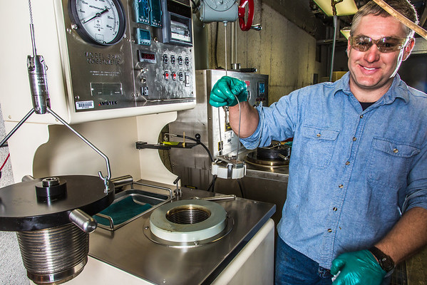 """Research professional Matt Bray studies pressurized petroleum samples in a Duckering Building rock mechanics lab.  <div class=""""ss-paypal-button"""">Filename: AAR-13-3919-33.jpg</div><div class=""""ss-paypal-button-end"""" style=""""""""></div>"""