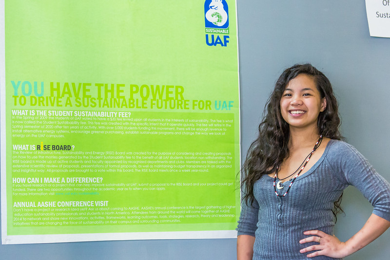 "Anthropology major Kristine Deleon stands by a poster promoting a sustainable campus during UAF's Research Day Poster Session in Wood Center.  <div class=""ss-paypal-button"">Filename: AAR-14-4169-65.jpg</div><div class=""ss-paypal-button-end""></div>"