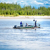 "Researchers with UAF's School of Fisheries and Ocean Sciences and the Alaska Center for Energy and Power (ACEP) check equipment on a prototype deployment boom on a barge anchored in the Tanana River near Nenana. They're part of a team conducting research on the feasibility of using the river current  to generate electricity for potential use throughout rural Alaska.  <div class=""ss-paypal-button"">Filename: AAR-12-3500-216.jpg</div><div class=""ss-paypal-button-end"" style=""""></div>"