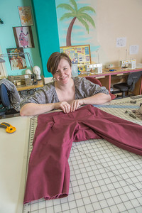 Student employee and theatre major Stephanie Sandberg enjoys sewing as part of her job in the costume shop at Theatre UAF.  Filename: AAR-14-4104-9.jpg