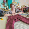"Student employee and theatre major Stephanie Sandberg enjoys sewing as part of her job in the costume shop at Theatre UAF.  <div class=""ss-paypal-button"">Filename: AAR-14-4104-9.jpg</div><div class=""ss-paypal-button-end"" style=""""></div>"