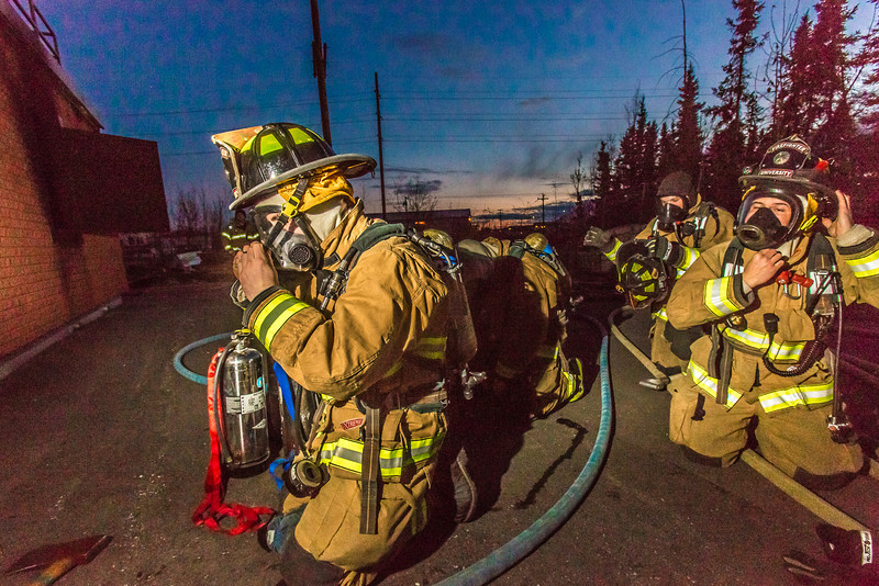 """Student firefighters don their masks before entering a burning building as part of a UFD live training drill at the Fairbanks Fire Training Center.  <div class=""""ss-paypal-button"""">Filename: AAR-13-3978-36.jpg</div><div class=""""ss-paypal-button-end"""" style=""""""""></div>"""