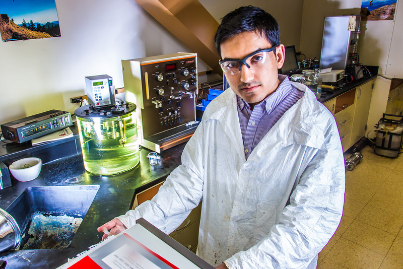"""Graduate student Behnam Zanganeh sets up apparatus for a procedure in UAF's Petroleum Development Lab in the Duckering Building.  <div class=""""ss-paypal-button"""">Filename: AAR-13-3918-211.jpg</div><div class=""""ss-paypal-button-end"""" style=""""""""></div>"""