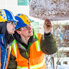 "Engineering students clear the bottom of one of the vertical supports as they raise the 2013 ice arch in Cornerstone Plaza on the Fairbanks campus. Students this year built the structure out of a mixture of ice and sawdust, which is many times stronger than concrete.  <div class=""ss-paypal-button"">Filename: AAR-13-3736-128.jpg</div><div class=""ss-paypal-button-end"" style=""""></div>"