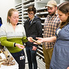 "Collection Specialist Julie Rousseau leads a group of students for a tour of the Museum of the North's lower level during the Life in the Age of Dinosaurs lab.  <div class=""ss-paypal-button"">Filename: AAR-14-4066-59.jpg</div><div class=""ss-paypal-button-end""></div>"