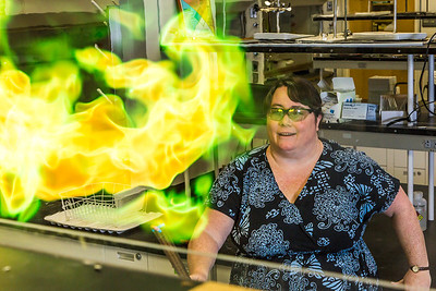 UAF chemistry professor Cathy Cahill seems to enjoy blowing up balloons filled with hydrogen during a demonstration for her students in a Reichardt Building lab.  Filename: AAR-13-4021-6.jpg