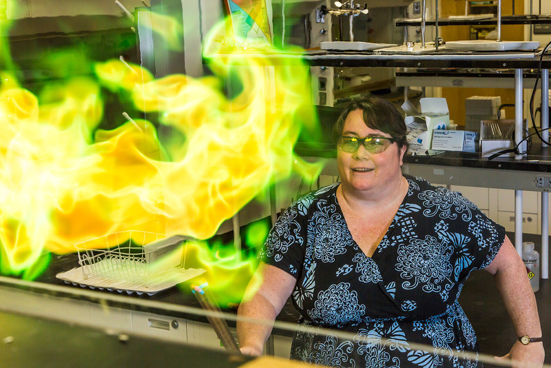 """UAF chemistry professor Cathy Cahill seems to enjoy blowing up balloons filled with hydrogen during a demonstration for her students in a Reichardt Building lab.  <div class=""""ss-paypal-button"""">Filename: AAR-13-4021-6.jpg</div><div class=""""ss-paypal-button-end""""></div>"""