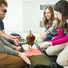 """Students from the Life in the Age of Dinosaurs class use a living avian dinosaur during a lab with Professor Sarah Fowell at the Museum of the North.  <div class=""""ss-paypal-button"""">Filename: AAR-14-4147-11.jpg</div><div class=""""ss-paypal-button-end""""></div>"""