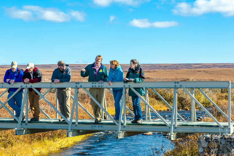 "Brian Barnes, director of UAF's Institute of Arctic Biology, and other UAF personnel, stop with Senator Lisa Murkowski on the foot bridge over the creek that feeds Toolik Lake, site of IAB's Toolik Field Station, about 330 miles north of Fairbanks on Alaska's North Slope in Sept, 2013.  <div class=""ss-paypal-button"">Filename: AAR-13-3929-383.jpg</div><div class=""ss-paypal-button-end""></div>"