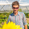 "Cameron Willingham, a research technician for UAF's School of Natural Resources and Agricultural Sciences, helps keep the research garden looking great during its late-summer glory.  <div class=""ss-paypal-button"">Filename: AAR-12-3494-49.jpg</div><div class=""ss-paypal-button-end"" style=""""></div>"