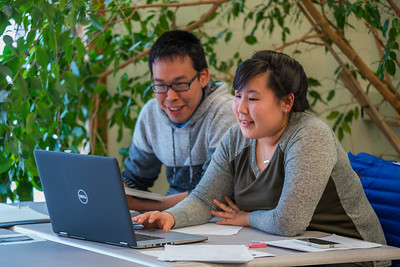 Corey Joseph, left, from Kwigillingok and Maryanna Jimmie from Bethel collaborate on a project at UAF's Kuskokwim Campus in Bethel.  Filename: AAR-16-4859-066.jpg