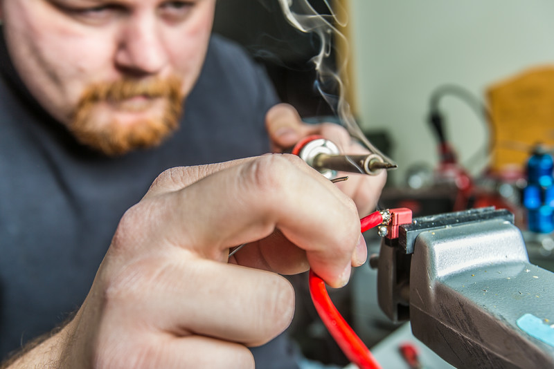 "Technician Michael Cook works on one of the unmanned aerial vehicles in UAF's Alaska Center for Unmanned Aircraft Systems Integration (ACUASI) shop in south Fairbanks.  <div class=""ss-paypal-button"">Filename: AAR-13-4026-48.jpg</div><div class=""ss-paypal-button-end""></div>"