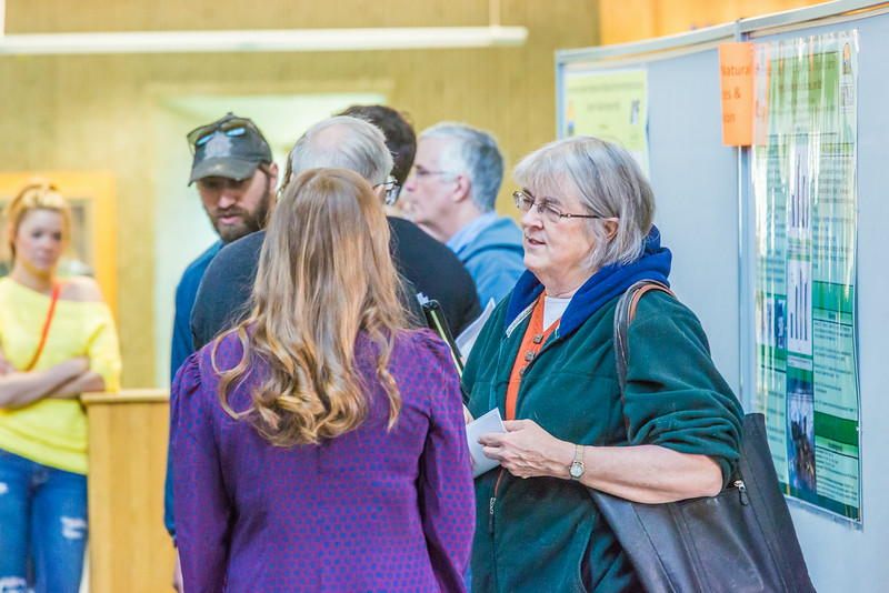 "Professor Pat Holloway, right, questions a student on her presentation during UAF's Research Day Poster Session in Wood Center.  <div class=""ss-paypal-button"">Filename: AAR-14-4169-29.jpg</div><div class=""ss-paypal-button-end""></div>"
