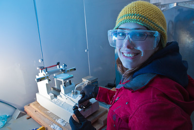 In temperatures hovering near -10°, sophomore Tiffany Green prepares a thin slice of ice for inspection of its crystal formation during a lab exercise in Prof. Erin Pettit's Ice in Climate Systems class in the Elvey Building's ice lab.  Filename: AAR-12-3330-042.jpg