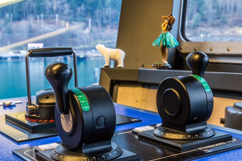 "A nanook and a hula dancer serve as good luck charms on the bridge of the R/V Sikuliaq while docked in Juneau during a stopover on its inaugural voyage to its home port of Seward in February, 2015.  <div class=""ss-paypal-button"">Filename: AAR-15-4458-26.jpg</div><div class=""ss-paypal-button-end""></div>"