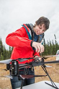 Students take part in a project using unmaned aerial vehicles (UAVs) at Poker Flat Research Range about 40 miles northeast of the Fairbanks campus. (Note: Taken as part of commercial shoot with Nerland Agency. Pretend class -- use with discretion!)  Filename: AAR-12-3560-027.jpg