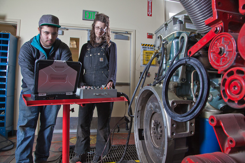 """CTC students Dayson Higgins and Missi Hacker run diagnostics in the diesel mechanics lab at the Hutchison Institute of Technology.  <div class=""""ss-paypal-button"""">Filename: AAR-12-3312-010.jpg</div><div class=""""ss-paypal-button-end"""" style=""""""""></div>"""