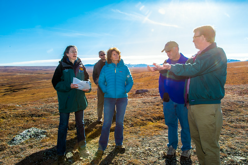 """Brian Barnes, director of UAF's Institute of Arctic Biology, describes some of the scientific research underway at Toolik to  Senator Lisa Murkowski (in blue down jacket) during the senator's brief visit to IAB's Toolik Field Station on Alaska's North Slope in Sept, 2013.  <div class=""""ss-paypal-button"""">Filename: AAR-13-3929-343.jpg</div><div class=""""ss-paypal-button-end""""></div>"""