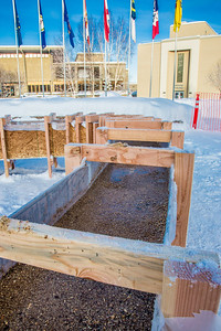 Water mixed with sawdust slowly freezes in the forms built by engineering students during construction of the traditional ice arch on the Fairbanks campus during the spring of 2013.  Filename: AAR-13-3718-02.jpg