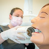 """CTC dental assistant student Abigail Bazon practices digital radiography at the program's facility on Barnette Street in downtown Fairbanks.  <div class=""""ss-paypal-button"""">Filename: AAR-16-4873-122.jpg</div><div class=""""ss-paypal-button-end""""></div>"""