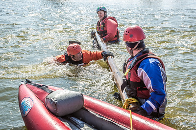 Staff members and graduate students from the Water and Environmental Research Center (WERC) and the Institute of Northern Engineering (INE) receive swiftwater rescue and safety training in the Chena River.  Filename: AAR-13-3813-122.jpg