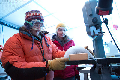 Assistant professor of geophysics Erin Pettit, left, cuts slices of glacier samples in the Elvey Building's ice lab.  Filename: AAR-12-3330-012.jpg