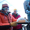 """Assistant professor of geophysics Erin Pettit, left, cuts slices of glacier samples in the Elvey Building's ice lab.  <div class=""""ss-paypal-button"""">Filename: AAR-12-3330-012.jpg</div><div class=""""ss-paypal-button-end"""" style=""""""""></div>"""