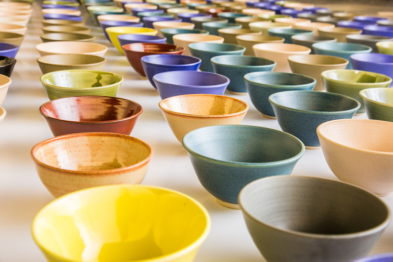 """A few of the 1,200 ceramic bowls made by art major Ian Wilkinson as part of his 2013 senior thesis.  <div class=""""ss-paypal-button"""">Filename: AAR-13-3770-15.jpg</div><div class=""""ss-paypal-button-end"""" style=""""""""></div>"""
