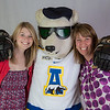 "UAF admissions counselors Caitlin Kaber, left, and Amy Bristor get a hug from a friend during an Inside Out event in the Wood Center ballroom.  <div class=""ss-paypal-button"">Filename: AAR-12-3470-38.jpg</div><div class=""ss-paypal-button-end"" style=""""></div>"